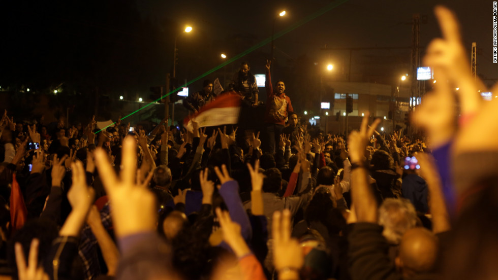 Members of the Egyptian opposition gather for a protest outside the presidential palace on Sunday, December 9, in Cairo. The palace has been the scene of violent clashes pitting thousands of protesters -- for and against Morsy.