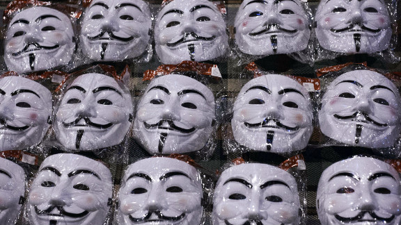 Guy Fawkes masks are displayed by a street vendor in front of the Egyptian presidential palace in Cairo on December 9. The masks depict Fawkes, a rebel executed in England