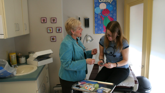 Volunteer diabetes educator B.J. Cline and patient Katie Lipsey at a Church Health Center clinic.