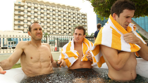 Australian football internationals Mark Schwarzer, Luke Wiltshire and Matt McKay grin and bear it as they suffer in the heat of Qatar.