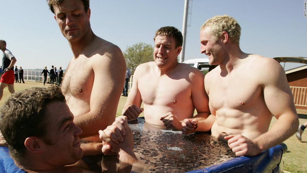 England rugby player Dean Schofield (second from right) looks far from happy while taking a dip during training in South Africa.