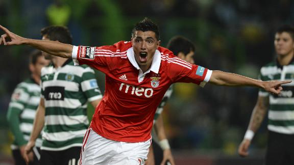 Paraguayan striker Oscar Cardozo celebrates as he aids Benfica