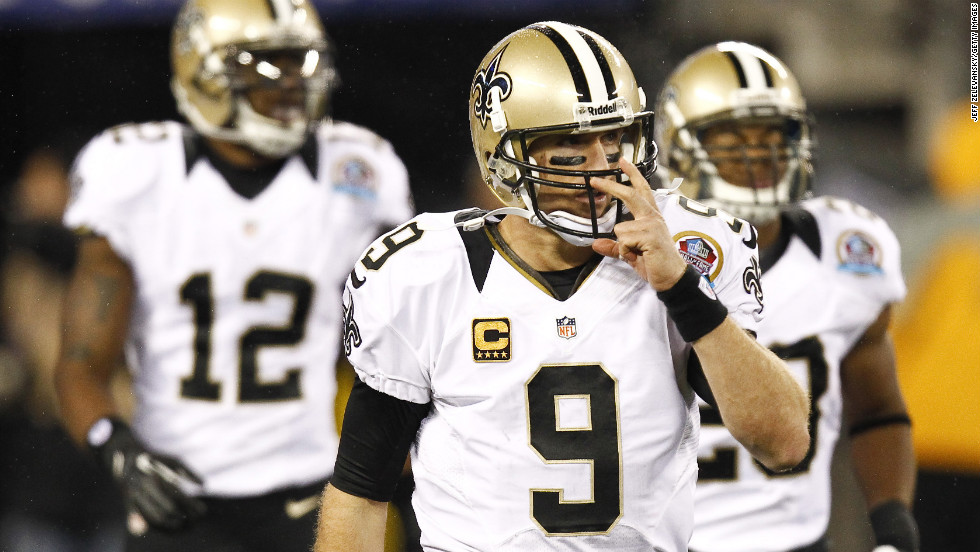 Saints quarterback Drew Brees walks to the sideline during their game against the Giants on Sunday.
