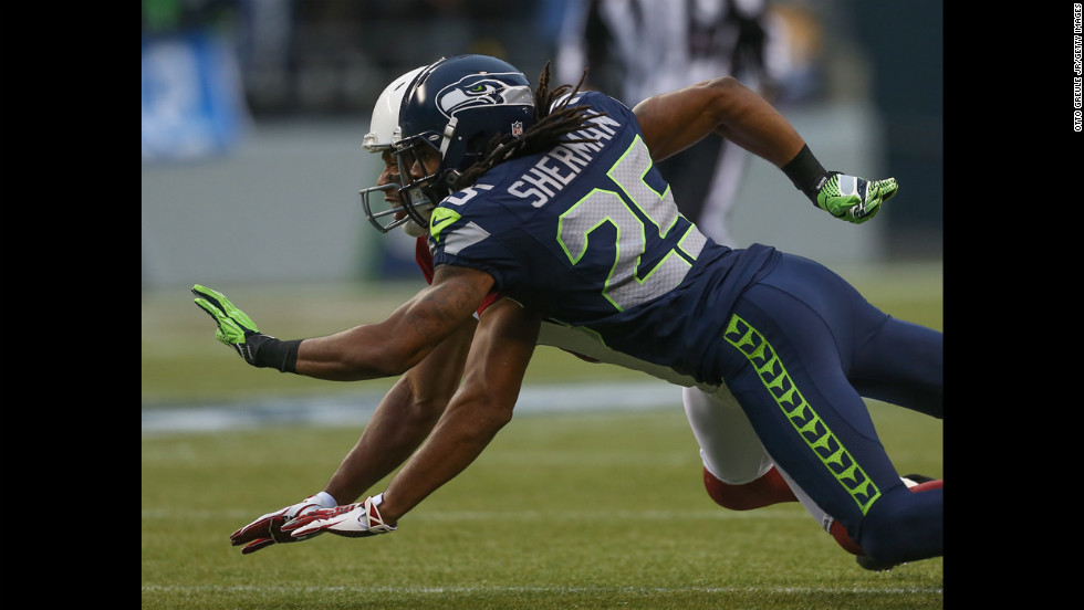 Cornerback Richard Sherman of the Seahawks defends on a pass intended for wide receiver Larry Fitzgerald of the Cardinals on Sunday.