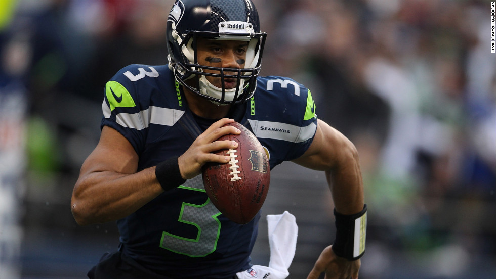 Seahawks quarterback Russell Wilson runs out of the pocket against the Cardinals in the first quarter on Sunday.