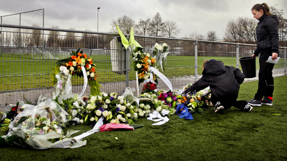 People lay flowers for Nieuwenhuizen at the Buitenboys clubhouse in Almere on December 9, 2012. Eight people have been arrested in connection with the attack, which came following a match against Amsterdam