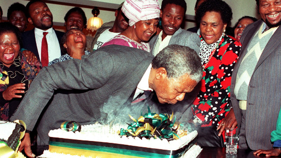 At his Soweto home on July 18, 1990, Mandela blows out the candles on his 72nd birthday cake. It was the first birthday he celebrated as a free man since the 1960s.