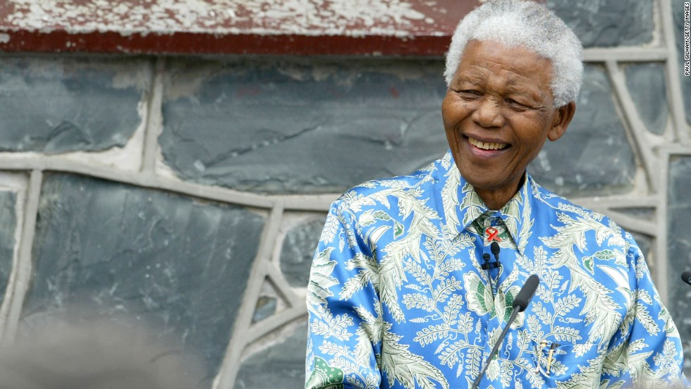 Mandela sits outside his former prison cell on Robben Island on November 28, 2003, ahead of his AIDS benefit concert at Green Point Stadium in Cape Town. He was sent to the infamous prison five miles off the coast of South Africa, where he spent 18 of his 27 years behind bars.