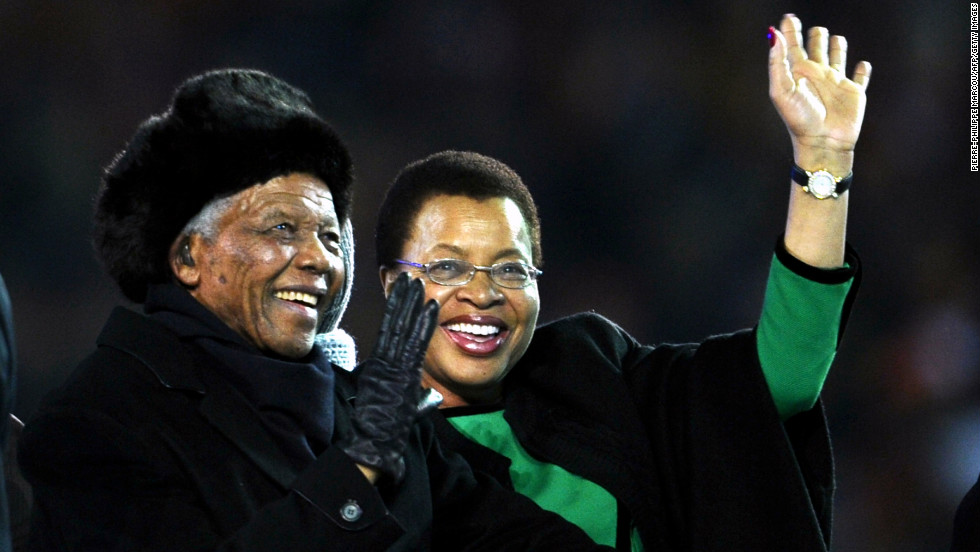 Nelson Mandela and his third wife, Graca Machel, arrive at the 2010 World Cup before the final match between Netherlands and Spain on July 11, 2010, at Soccer City Stadium in Soweto.