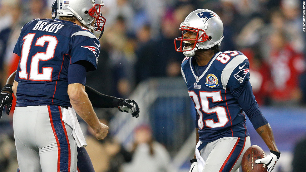 "Brandon Lloyd of the New England Patriots, right, celebrates his touchdown with quarterback Tom Brady during the game against the Houston Texans on Monday, December 10, at Gillette Stadium in Foxboro, Massachusetts. Check out the action from Week 14 of the NFL and then <a href=""http://www.cnn.com/2012/11/29/worldsport/gallery/nfl-week-13/index.html"">look back at the best photos from Week 13</a>."