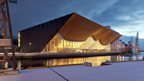 The Kilden Theatre overlooks the harbour of Kristiansand in Norway. Its bold sculptural ceiling was designed using techniques from traditional boat construction.