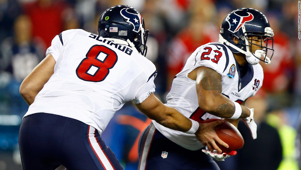 Texans quarterback Matt Schaub hands the ball off to running back Arian Foster during Monday's game against the Patriots.