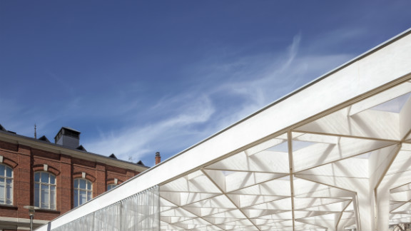 A lattice timber canopy gives a feeling of lightness to the pavilion. The structure will be recycled for a new architectural project next year.