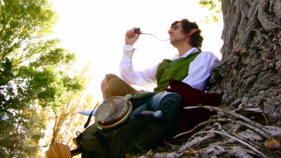 """Jeffrey Root of Provo, Utah, says he became captivated with Tolkien's Middle-earth four years ago while taking a college course on the author. He was already a fan after seeing """"The Lord of the Rings"""" films, but the class hooked him. Here he is in his homemade Bilbo Baggins costume (which he will wear to """"The Hobbit"""") looking at home in """"the Shire."""""""