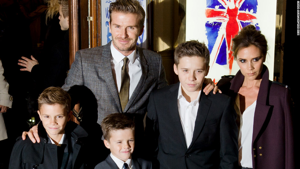 "David Beckham and Victoria Beckham pose with three of their four children at the press night of ""Viva Forever,"" a musical based on the music of the Spice Girls, in London on Tuesday."