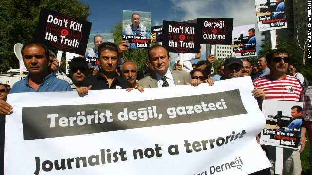 Over 100 Turkish journalists protest outside Syrian Embassy, Ankara, August 31, 2012, for two Turkish reporters' release.