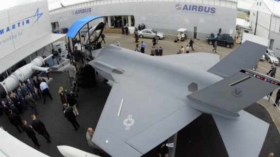 A model of the F-35 Joint Strike Fighter is on display at an airshow in 2004. The writers say it's outmoded and hugely expensive.
