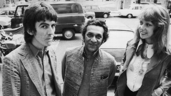 Shankar poses with Beatle George Harrison, left, and Harrison