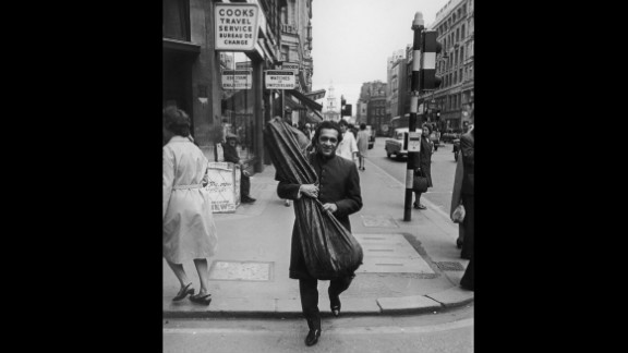 Shankar walks the streets of London with his sitar during a visit circa 1967.