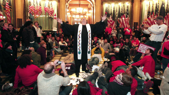 Union members hold a sit-in in the rotunda of the Michigan State Capitol as they protest the right-to-work legislation.