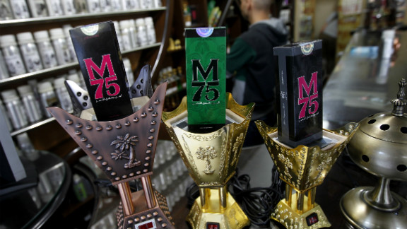 """The perfume comes in different versions for men and women, and is marketed with the slogan: """"Whoever loves victory, happiness and dignity, loves the M75 perfume."""""""