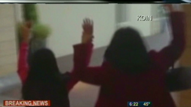 People leave Oregon mall with arms up