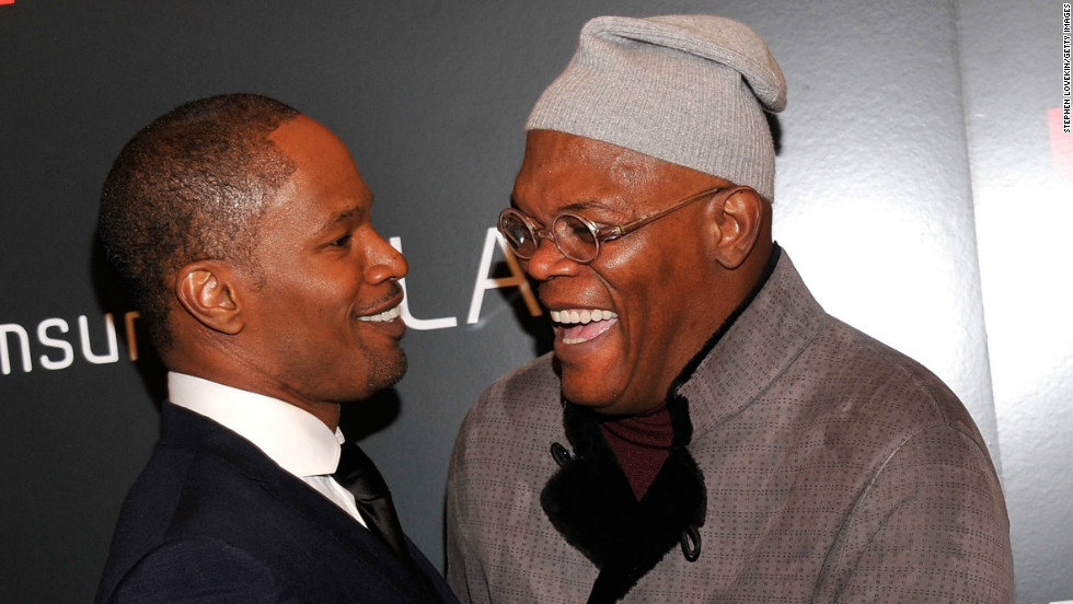 "Jamie Foxx and Samuel L. Jackson share a laugh as they arrive at a screening of ""Django Unchained"" in New York City on December 11."