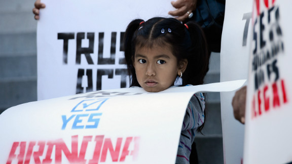 """The Supreme Court ruled in June to uphold the Arizona immigration law's most controversial feature -- the """"show your papers provision"""" that allows police to check a person's immigration status while enforcing other laws. But the decision also dismissed Arizona's right to regulate immigration at the state level - bringing the debate back to square one."""