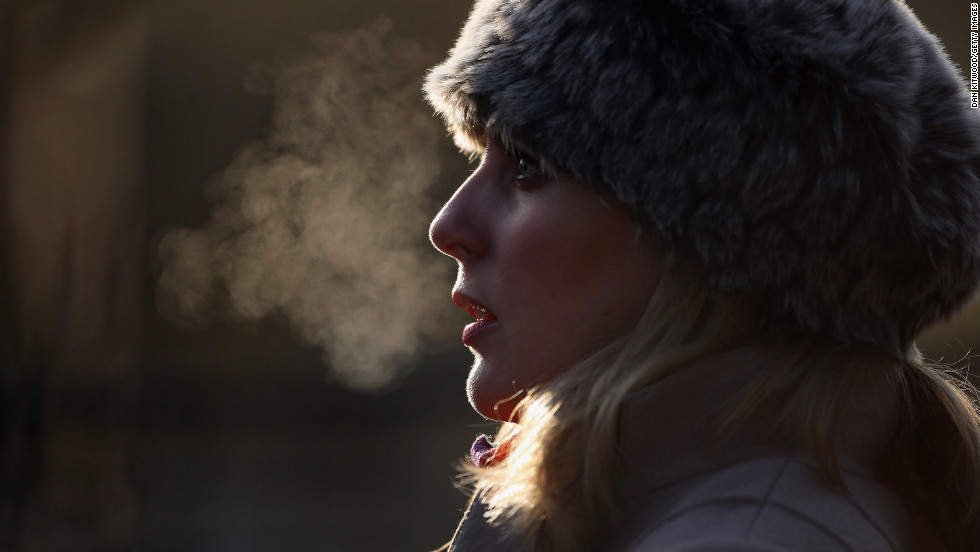 A woman's breath shows on a freezing morning in Regents Park on December 12 in London, England.