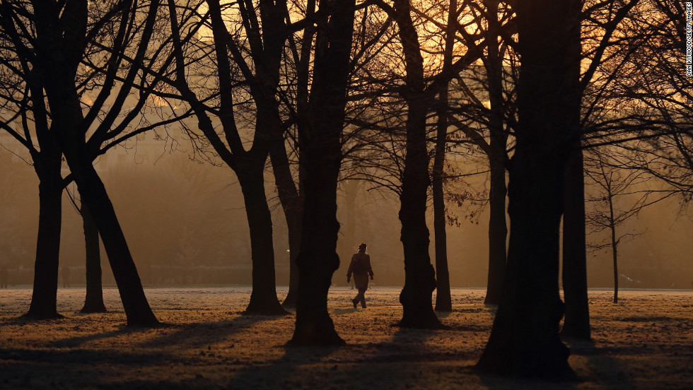 A man walks through the early morning frost in Regents Park on December 12.
