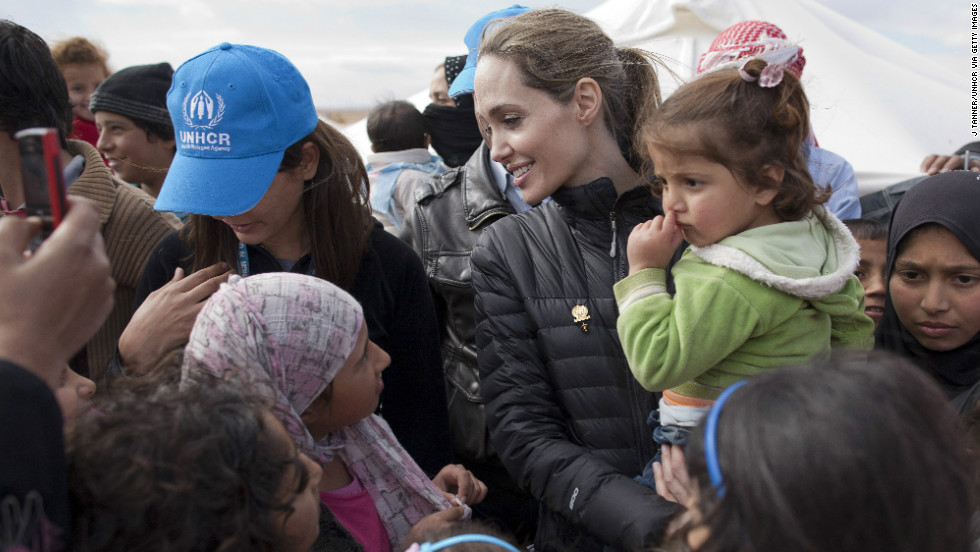 In this handout image provided by UNHCR, UNHCR Special Envoy Angelina Jolie meets with refugees at the Zaatari refugee camp on December 6, 2012 outside of Mafraq, Jordan.