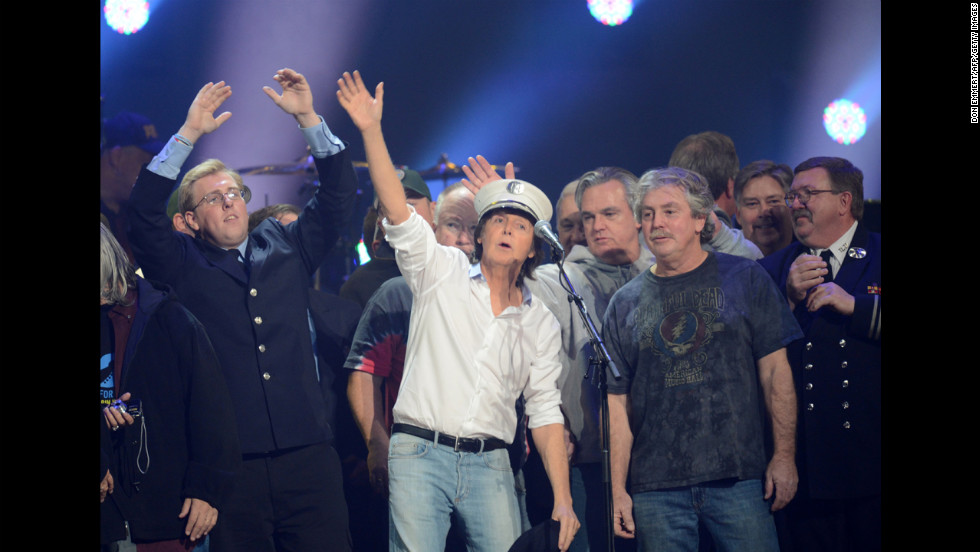 Sir Paul McCartney performs on stage with a crowd during the concert finale. Proceeds from 12-12-12 benefited the Robin Hood Relief Fund, which assisted storm victims in New York, New Jersey and Connecticut.