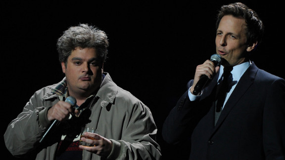 On December 12, 2012, Bobby Moynihan, left, and Meyers perform onstage at New York
