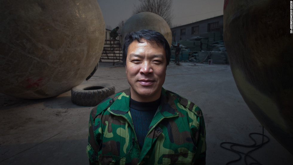 Liu stands among his pods, which he built in his yard in the village of Qiantun in China's Hebei province.