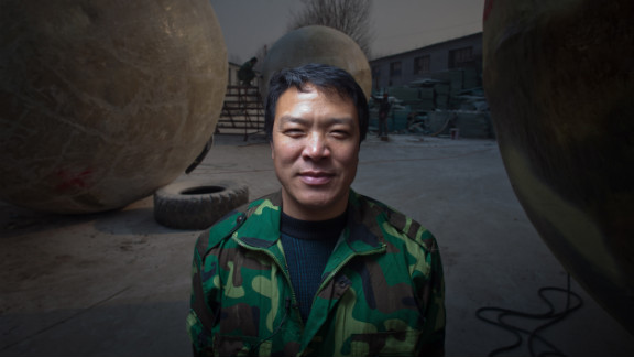 Liu stands among his pods, which he built in his yard in the village of Qiantun in China