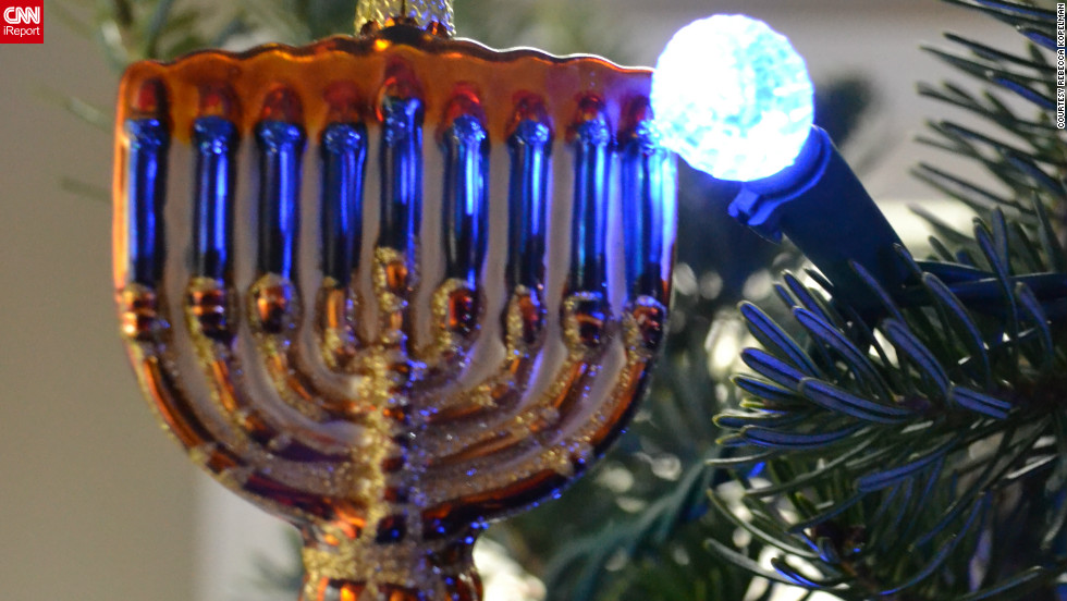 "When the holiday season rolls around, some interfaith households <a href=""http://ireport.cnn.com/topics/891452"">celebrate a combination of holidays</a>. Christmas and Hanukkah, dubbed by some as Chrismukkah, is one example. Find out how these families celebrate this blended holiday."