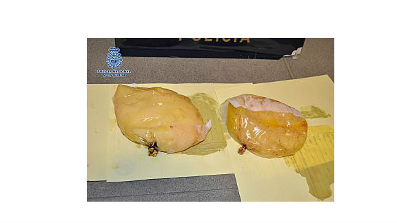 A woman was arrested in the El Prat airport in Spain for carrying cocaine in her breast implants.