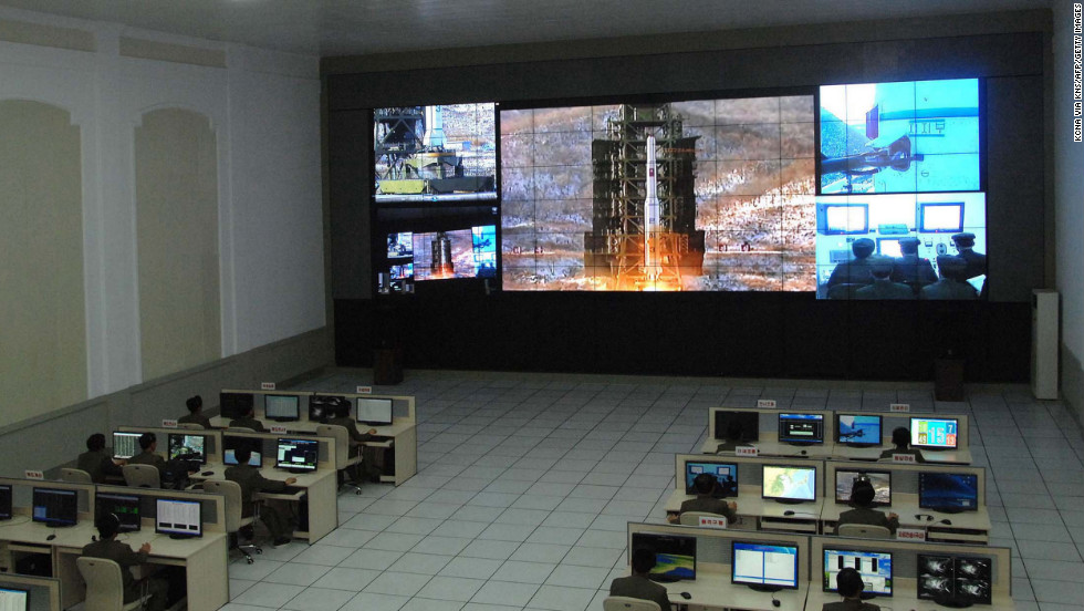 Technicians monitor the launch at the control center. The event allowed North Korea to flex its military and technological muscle on the world stage.
