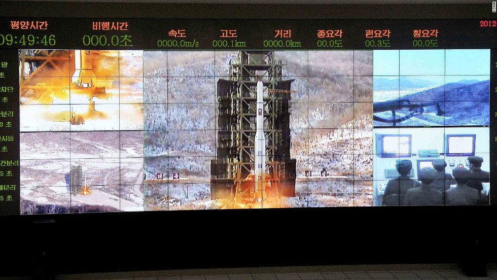 The Wednesday morning launch is seen from multiple angles on a large screen at the satellite control center in Cholsan County.