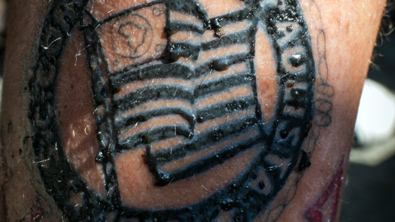 A Corinthians fans shows off his tattoo with the emblem of the team in Sao Paulo.