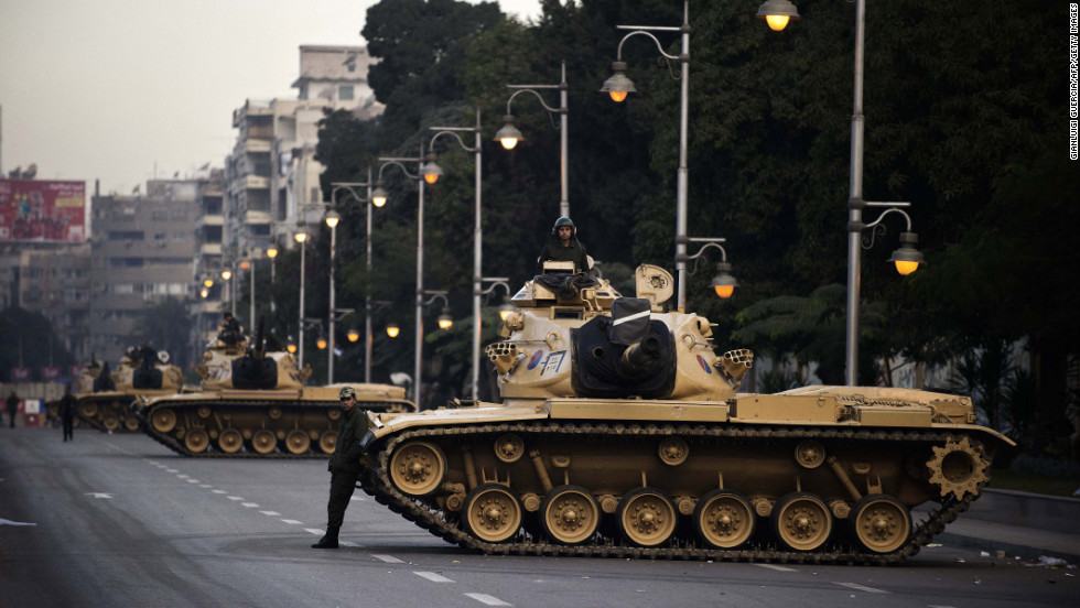 Egyptian army tanks are deployed outside the presidential palace in Cairo on Thursday, December 13. Egypt's crisis showed no sign of easing as the army delayed unity talks meant to ease political divisions and the opposition set near-impossible demands for taking part in a looming constitutional referendum.