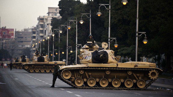 Egyptian army tanks are deployed outside the presidential palace in Cairo on Thursday, December 13. Egypt