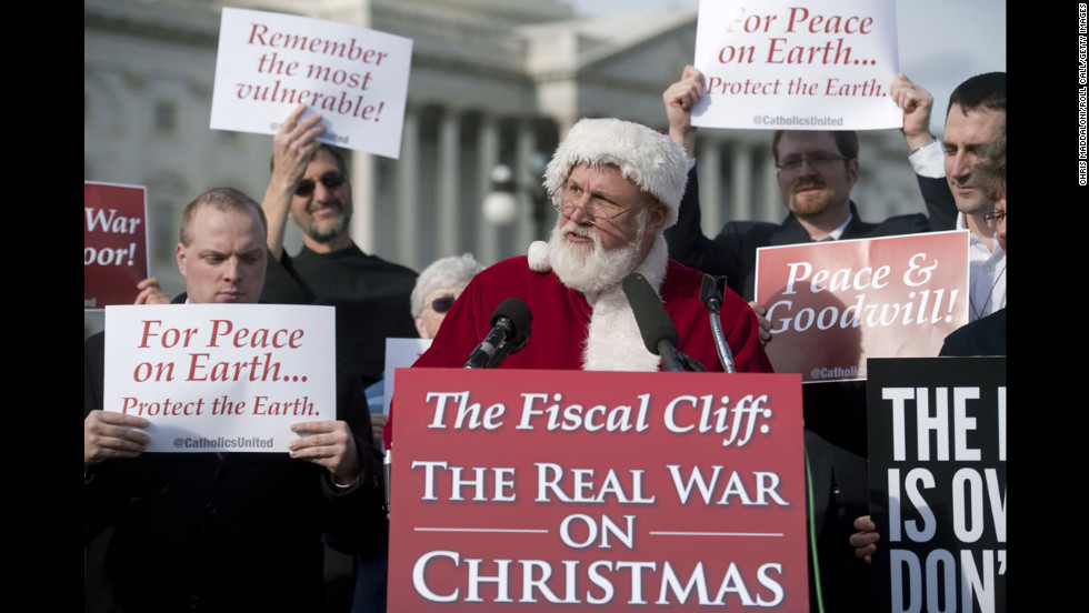 Catholics United hold a press conference with Santa Claus in front of the U.S. Capitol to rebut the GOP's budget effort in the ongoing fiscal cliff argument on December 12 in Washington.