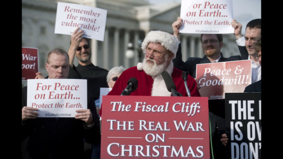 Catholics United hold a press conference with Santa Claus in front of the U.S. Capitol to rebut the GOP