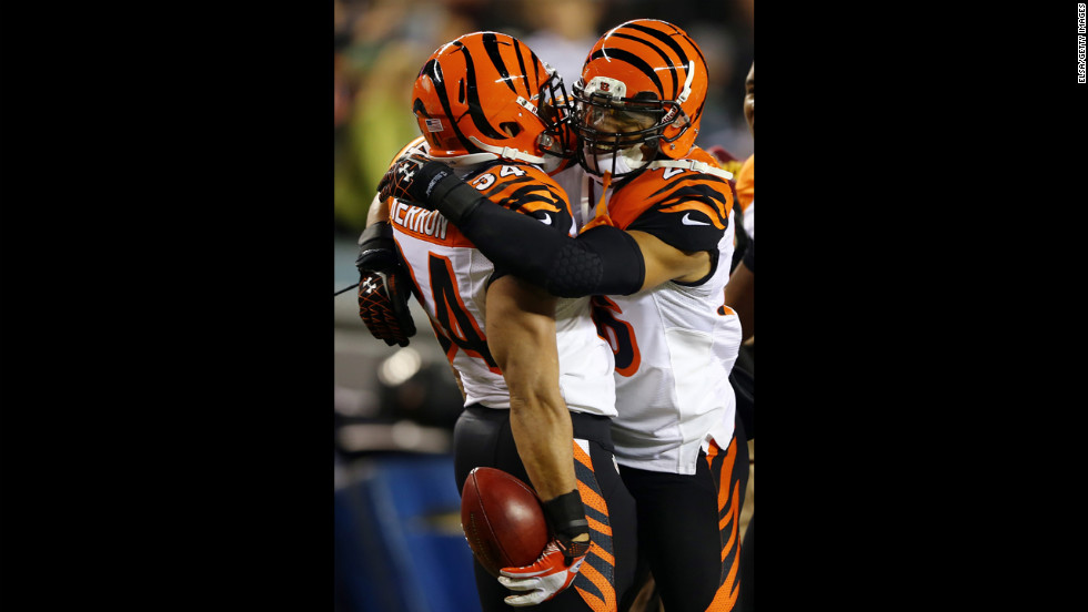 Dan Herron of the Cincinnati Bengals is congratulated by teammate Taylor Mays after Herron recovered a fumble from his blocked punt in the first quarter against the Philadelphia Eagles on December 13.