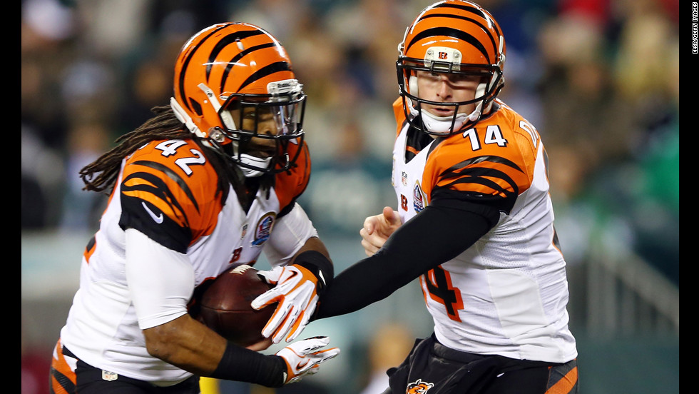 Andy Dalton of the Cincinnati Bengals hands the ball off to BenJarvus Green-Ellis in the first quarter against the Philadelphia Eagles on December 13.