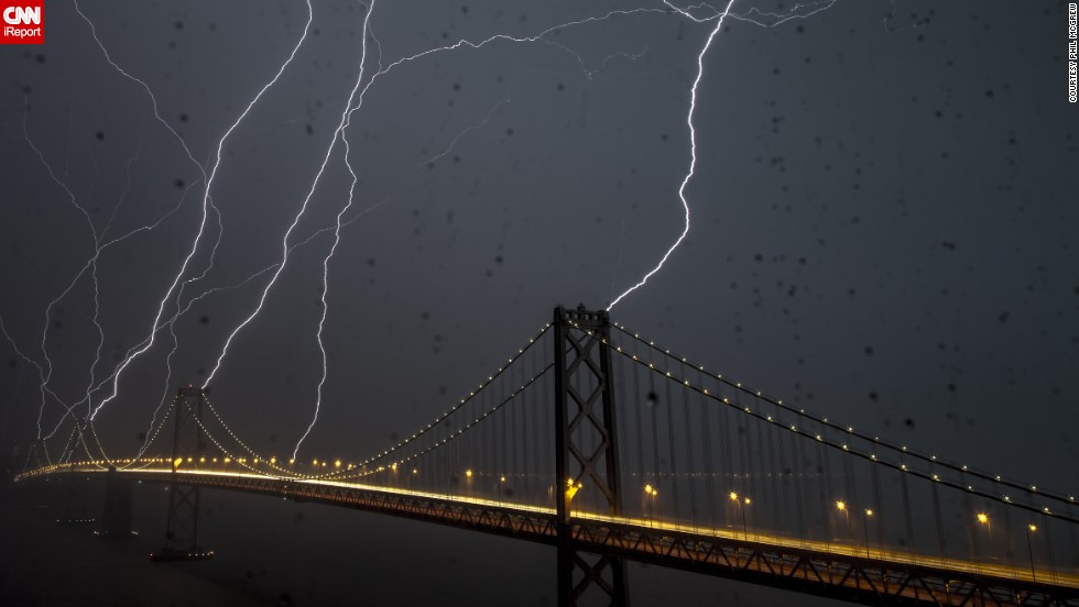 "<a href=""http://ireport.cnn.com/docs/DOC-890265"">Phil McGrew</a> kept his camera going for an hour and a half as a storm passed over San Francisco's Bay Bridge in April 2012. He shot this 20-second exposure through a rain-soaked window. ""Lightning is rare here, but I always thought it (the bridge) would be a pretty good target for lightning,"" he said."