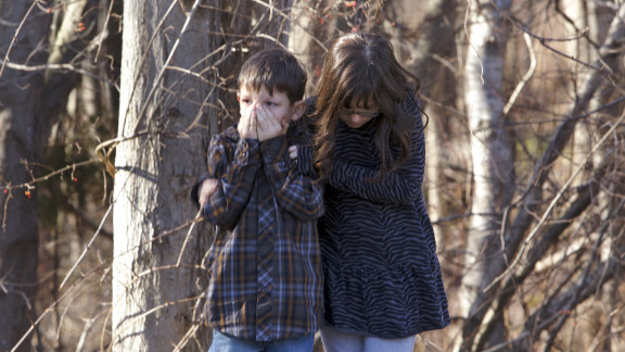 Children wait outside Sandy Hook Elementary School in Newtown, Connecticut, after the shooting.