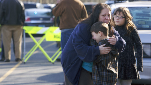 A young boy is comforted outside Sandy Hook Elementary School on December 14.
