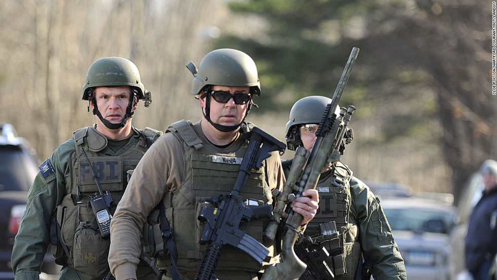 FBI SWAT team members walk along Dickinson Drive near Sandy Hook Elementary School on December 14.